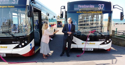 Councillor Dee Simpson, Mayor of Brighton & Hove, having just cut the tape to launch the start of the new service. Alongside her is Chris Chatfield, Managing Director of Compass Travel.